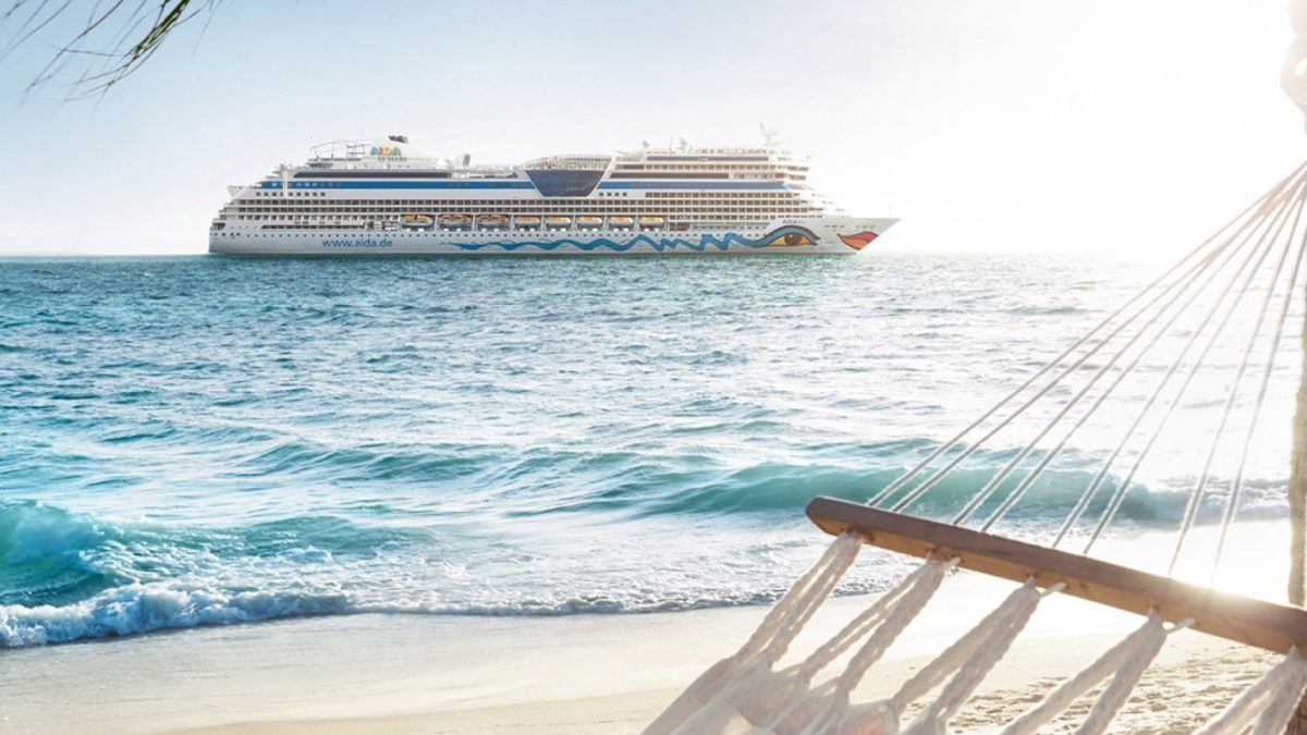 Beach with a AIDA cruiseship in the background